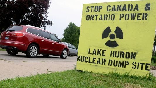 A sign disapproving the planned Lake Huron nuclear dump site is displayed Monday, Aug 10, along Military Street in Port Huron.