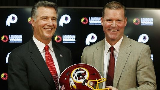 Redskins president Bruce Allen, left, and GM Scot McCloughan.