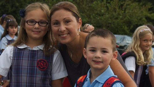 The Strain family enjoyed the first day of school at Bishop Schad Regional School in Vineland in 2014.