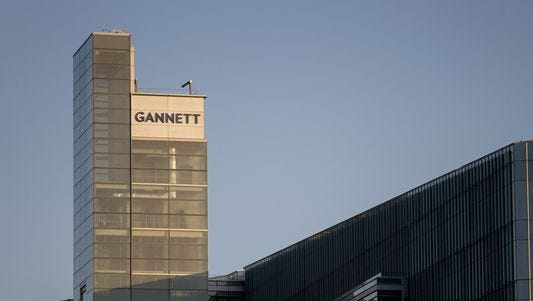 The Gannett Co. Inc. headquarters stands in McLean, Virginia, U.S., on Friday, July 24, 2015. Following a June 29 spinoff of its broadcasting and digital businesses into a new company Tegna Inc., the new Gannett Co. Inc. has a portfolio of 110 media outlets in the U.S. and U.K., including USA Today and Newsquest, a regional U.K. publisher. Photographer: Andrew Harrer/Bloomberg ORG XMIT: 566599943