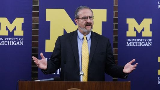 University of Michigan President Mark Schlissel addresses the media at the Regents' Room of the Fleming Administration Building while announcing the resignation of University of Michigan Athletic Director Dave Brandon during a press conference on Friday October 31, 2014 at the Ann Arbor campus.