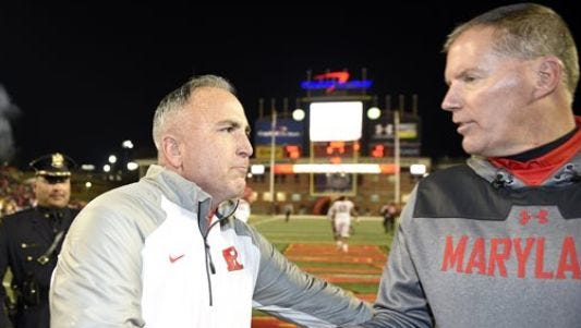 Rutgers coach Kyle Flood and then-Maryland coach Randy Edsall shake hands after last season's game.
