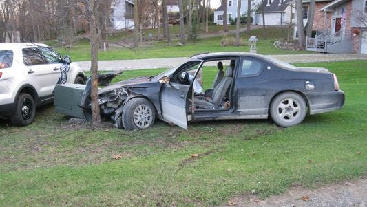 Hamburg Township police say the driver of this Chevrolet Monte Carlo tried to flee police Wednesday evening.