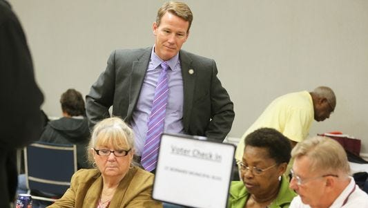 Ohio Secretary of State Jon Husted watches as poll workers in St. Bernard use the new electronic poll books in the Nov. 3 election.