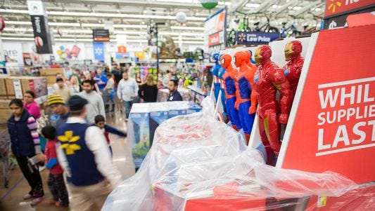 Action figure toys on display at a Walmart store on Thursday, Nov. 26, 2015 in Rogers, Ark. Toys were among the top-sellers for retailers on Thanksgiving.