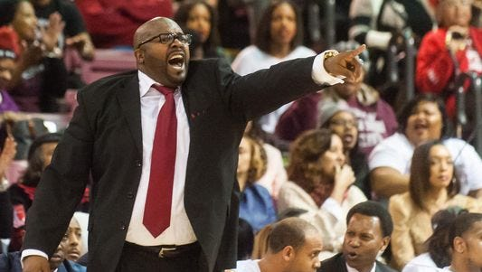 UMES head coach Bobby Collins instructs his players at the W.P. Hytche Athletic Center during a 2014 game.