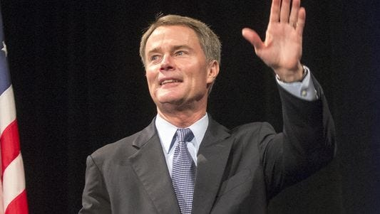 Joe Hogsett waves to the crowd at Union Station after winning election as Indianapolis' next mayor.