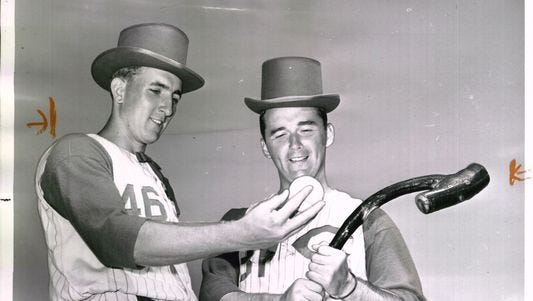 Reds pitchers Jim Maloney, left, and Jim O'Toole (right) ham it up in anticipation of 1961 St. Patrick's Day celebrations.