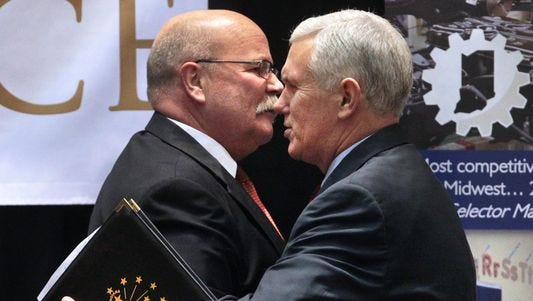 Ind. Gov. Mike Pence (right) and former Speaker of the House John Gregg at the Indiana Convention Center in Indianapolis on Dec. 5, 2013. Pence, a Republican, and Gregg, a Democrat, are squaring off in the governor's race.
