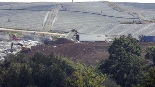 Garbage haulers dump trash at Middle Point Landfill on East Jefferson Pike north of Murfreesboro.