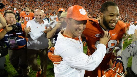 Clemson defensive end Kevin Dodd, at right with coach Dabo Swinney after the Tigers' win over Florida State, is entering the NFL Draft.