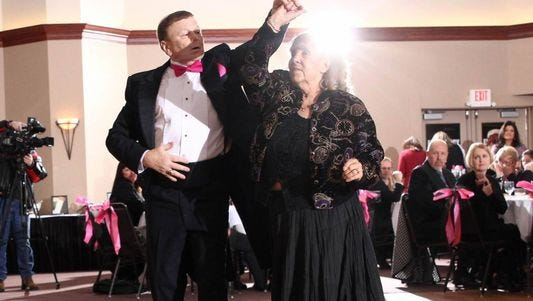 John Botsford and his partner, Eunice Sheberl, perform the Viennese Waltz at the Mid-Day Women's Alliance Black and Pink Ball in Menasha. John and Eunice danced at the Hofburg Palace's New Year's Eve ball in Austria.