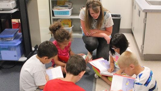 Children work in small groups to increase reading skills and comprehension through the Mesquite Reads program.