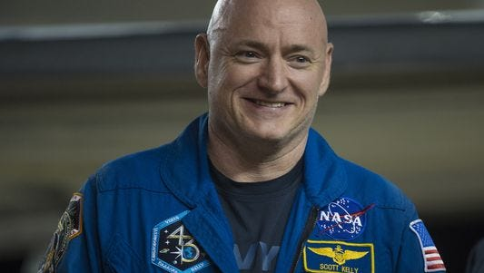In this handout provided by NASA, Scott Kelly of NASA is seen as he arrives after landing at Ellington Field after his return to Earth on March 3, 2016 in Houston, Texas.