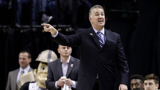 Purdue Boilermakers head coach Matt Painter gets after his defense against the Illinois Fighting Illini at Bankers Life Fieldhouse in Indianapolis on March 11, 2016.