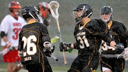 Hartland senior Andrew Spisz (31) is playing lacrosse, his sport of choice for college, after losing a controversial 2-1 semifinal match at the individual state wrestling tournament.