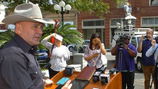 Capt. Clay Higgins announces his retirement from the St. Landry Parish Sheriff's Department during a press conference on the steps of the St. Landry Parish Courthouse in February.