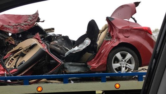 The remains of Myrian Romero's red Hyundai after the crash on Palisades Interstate Parkway, May 2, 2016.