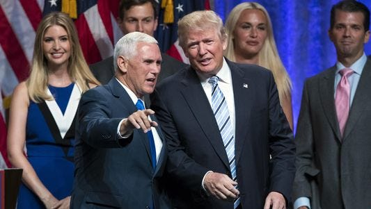 Republican presidential nominee Donald Trump spoke with Indiana Gov. Mike Pence during a campaign event Saturday, July 16, 2016, to announce Pence as his vice presidential running mate.