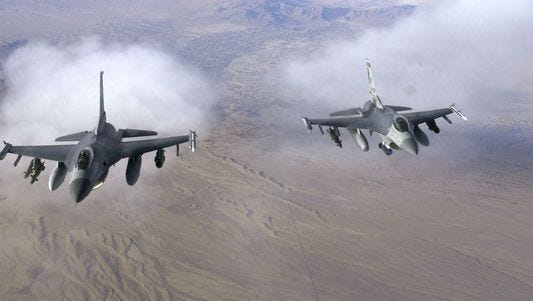 A pair of F-16 Fighting Falcons fly a patrol mission over Afghanistan.