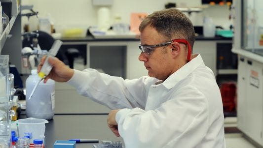 An employee at Eli Lilly and Co. works in the biotechnology complex.