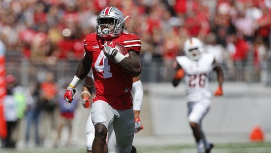Ohio State's Curtis Samuel pulls away from a defender during the Buckeyes 77-10 win over Bowling Green Saturday in Columbus.