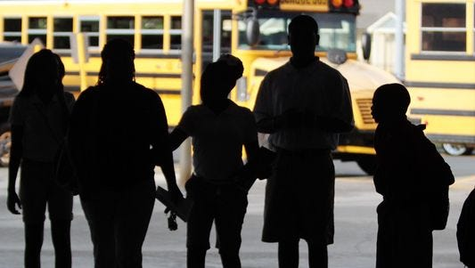 Students wait for buses at a Louisiana middle school.