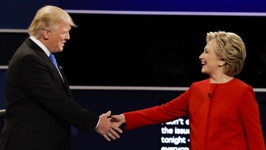 Republican presidential nominee Donald Trump and Democratic presidential nominee Hillary Clinton shake hands during the first presidential debate Sept. 26.