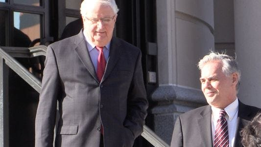Ramapo Supervisor Christopher St. Lawrence leaving the federal courthouse in White Plains with his attorney, Patrick Burke of Suffern.