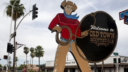 The historic cowboy sign in downtown Scottsdale.