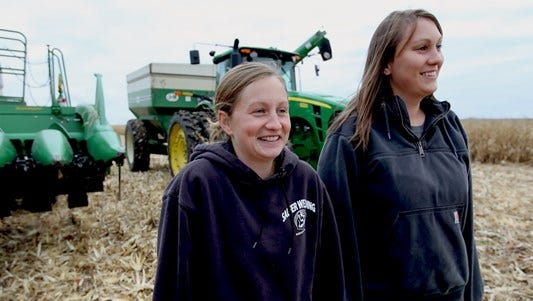 Sisters Kaycee, left, and Miranda Altermatt during their corn harvest,