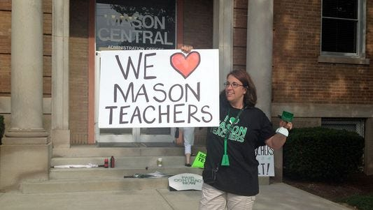 About 300 Mason teachers and supporters gathered in front of the Mason City Schools' administrative offices on in 2014 to support the union's ongoing contract negotiations with the school board.