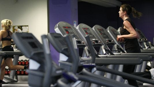 In this 2010 file photo, a woman exercises on a machine in a gym in central London.