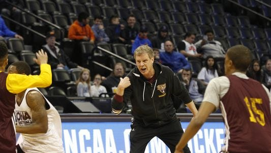 Iona head coach Tim Cluess leads his players through practice Wednesday, March 16, 2016, at the Pepsi Center in Denver.
