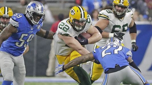 Green Bay Packers fullback Aaron Ripkowski (22) runs the ball against the Detroit Lions at Ford Field Sunday, January 1, 2017.