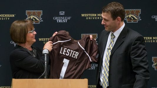 Western Michigan athletic director Kathy Beauregard presents football coach Tim Lester with a jersey as he was introduced Saturday, Jan. 14, 2017.