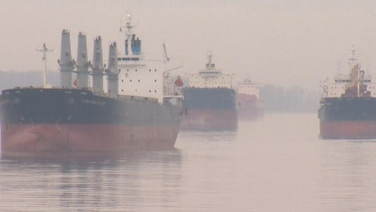 Ships await the chance to unload on the Columbia River.