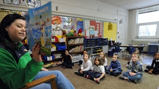Student listen to a story at Marion's St. Mary Elementary School. In 2015, roughly 40 percent of the school's students used state vouchers to help with tuition.