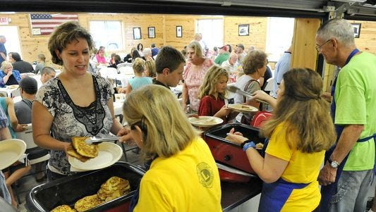 The Kimball Town Lions Club serve a sausage and pancake breakfast in 2014 at Willow Creek Park in Kimball.