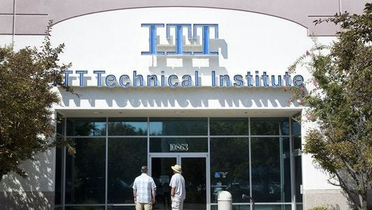 Individuals stand outside a closed ITT Technical Institute campus in California in September 2016. Four years ago, ITT closed all of its 137 campuses, including one that operated in Springfield.