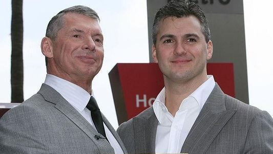 WWE Chairman Vince McMahon with his son Shane at the Hollywood Walk of Fame ceremony on March 14, 2008.
