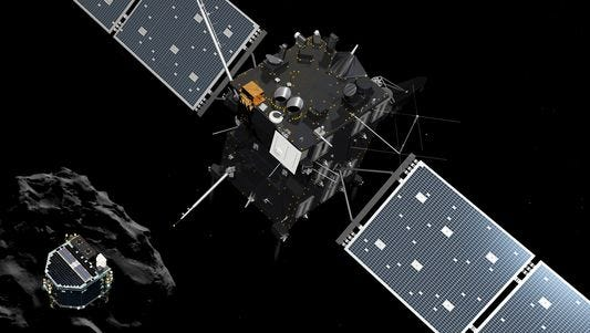 An artist rendering by the ATG medialab depicting lander Philae separating from Rosetta mother spaceship and descending to the surface of comet 67P.