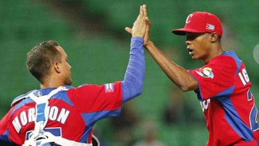 Pitcher Raisel Iglesias (right) celebrates with catcher Frank Morejon after Cuba defeated Brazil during the 2013 World Baseball Classic.