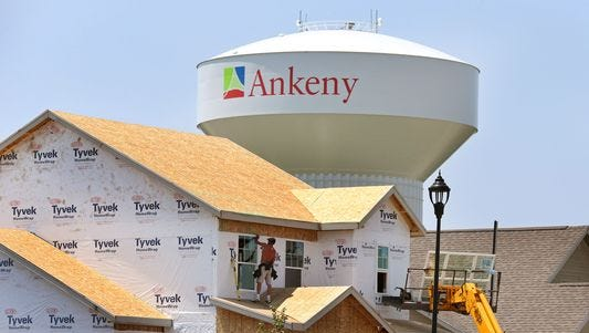Construction crews work on a new home in 2014 in Ankeny.