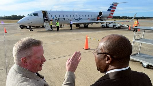 Thomas Heanue, executive director of the Hattiesburg-Laurel Regional Airport, left, talks with Mayor Johnny DuPree for the inaugural flight of American Eagle at the Hattiesburg-Laurel Regional Airport Thursday. Through American Eagle the Hattiesburg-Laurel Regional Airport is now providing flights to and from Dallas/Fort Worth.