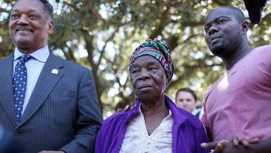 Rev. Jesse Jackson, left, stands with Nowai Korkoyah, the mother of Ebola patient Thomas Eric Duncan, and his nephew, Josephus Weeks, after they spoke to the media at the Texas Health Presbyterian hospital on Tuesday in Dallas, Texas.