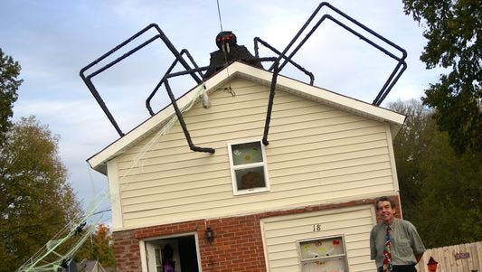 Gallatin resident George Snider stands outside the North Water Avenue home he and his wife have decorated for Halloween. It took Snider three days to build the giant spider and place it on the roof of the house.