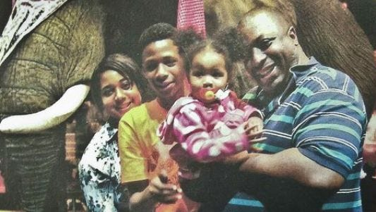In this undated family photo provided by the National Action Network, Saturday, July 19, 2014, Eric Garner, right, poses with his children during during a family outing.(Photo: Photo: Family photo/AP)