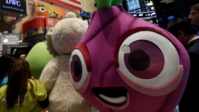Characters from King Digital Entertainment's Candy Crush Saga gather on the floor of the New York Stock Exchange on Wednesday.