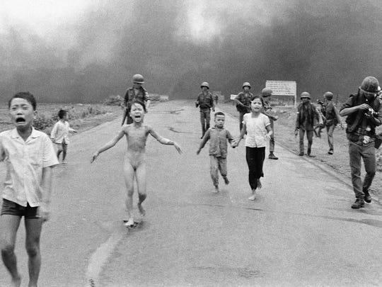 Nine-year-old Phan Thi Kim Phuc (center) runs naked and severely burned after a napalm attack in South Vietnam in 1972.